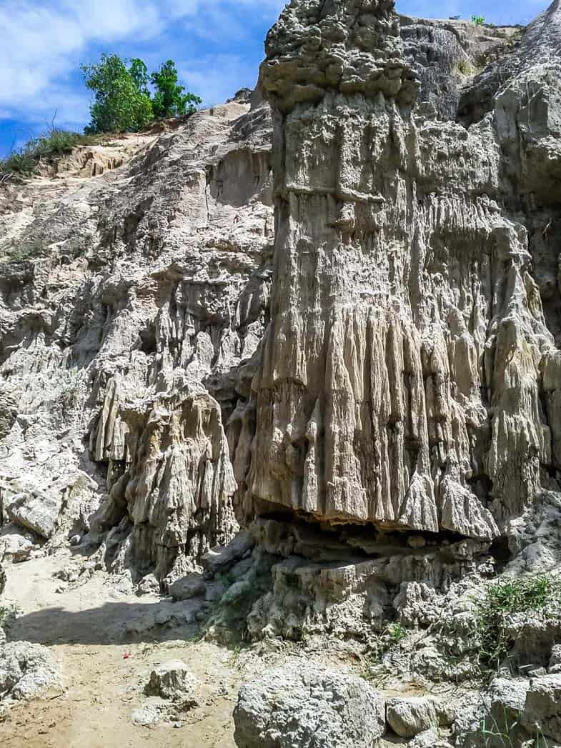 Sandy rock formations look like melted candles at this weird attraction in Southeast Asia