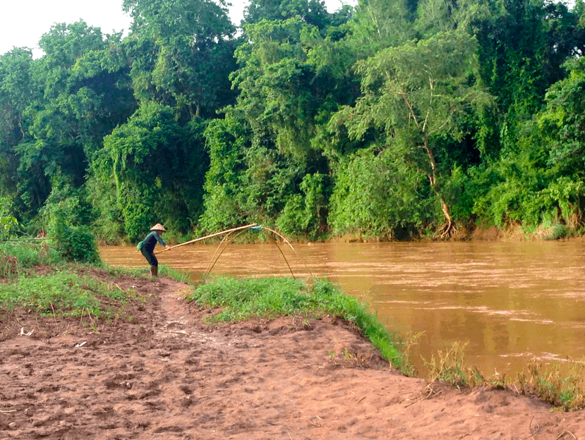 Local women at the river, a popular things to do in Luang Namtha