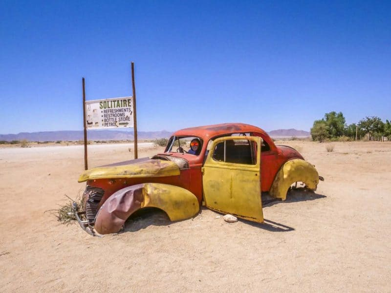 Old and rusty car wreck at the Namib desert, Solitaire, Namibia