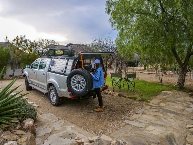 unloading camping equipment from car at our 2 week Namibia trip
