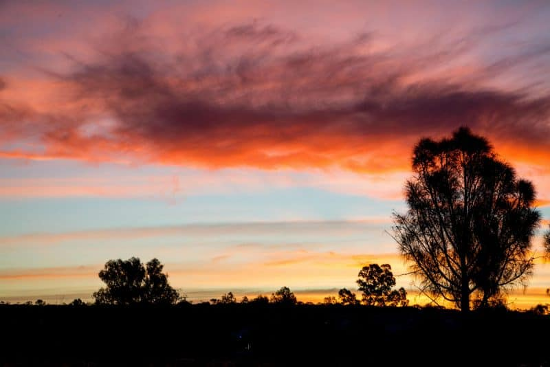 Seeing sunset is a must things to do near Alice springs.