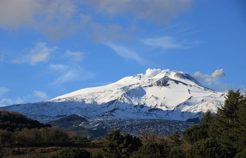 Towering over the eastern Sicily, Mount Etna is one of the world's most iconic volcanoes.