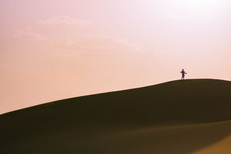 A man on the sanddunes on our Morocco desert tour.