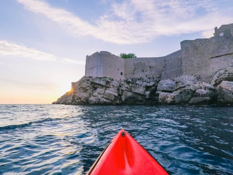 Kayaking Dubrovik's old walls on a group tour for your first time abroad