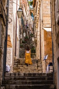 Woman on the stairs in Dubrovnik