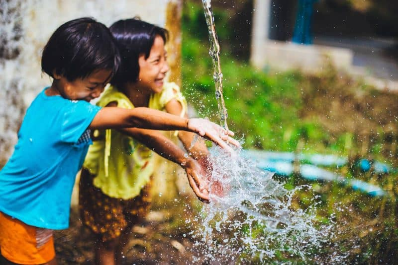 children playing water