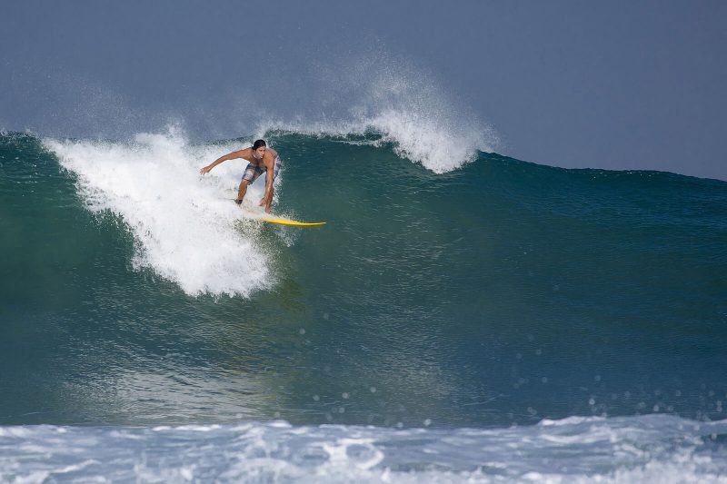 Surfing on Plengkung beach Indonesia