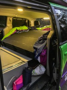 The back of the JUCY van and the bed folded