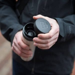 man with coffee maker - travel accessory