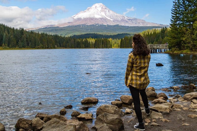 Woman at lake below Mt Hood