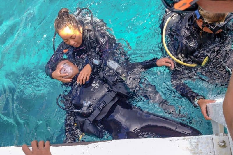 Scuba instructor practicing rescue