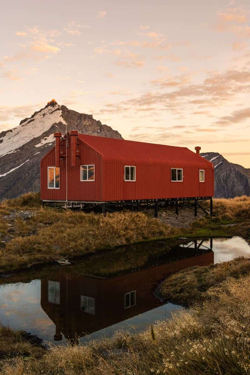 French ridge hut sunset reflection