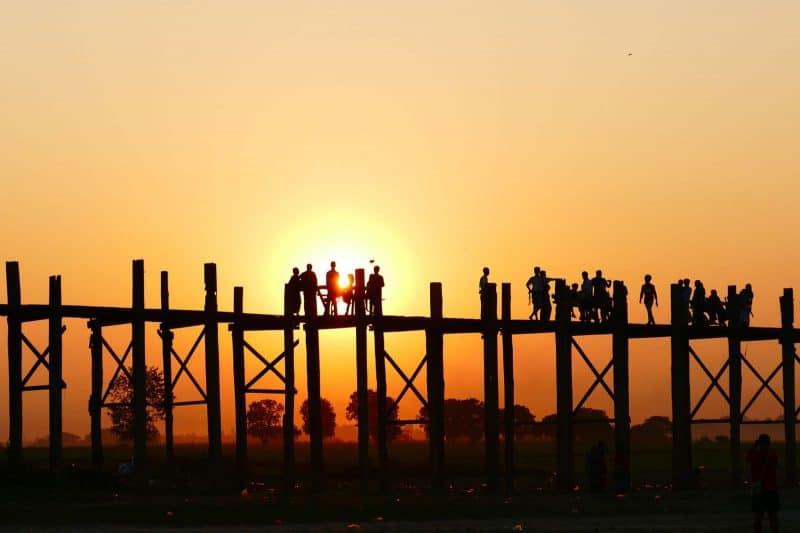 people on U Bein bridge during sunset