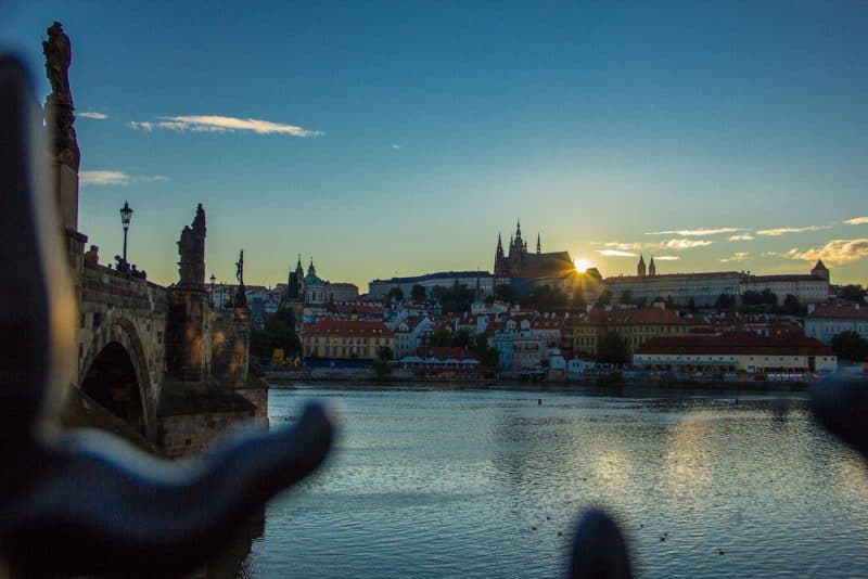 sunset over Prague castle from Charles bridge