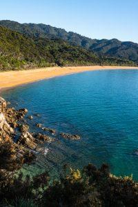Totaranui campervan site New Zealand beach view
