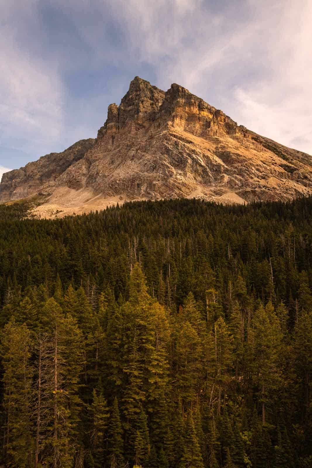 The breathtaking mountain area of Cracker Lake located near a trail in Glacier National Park