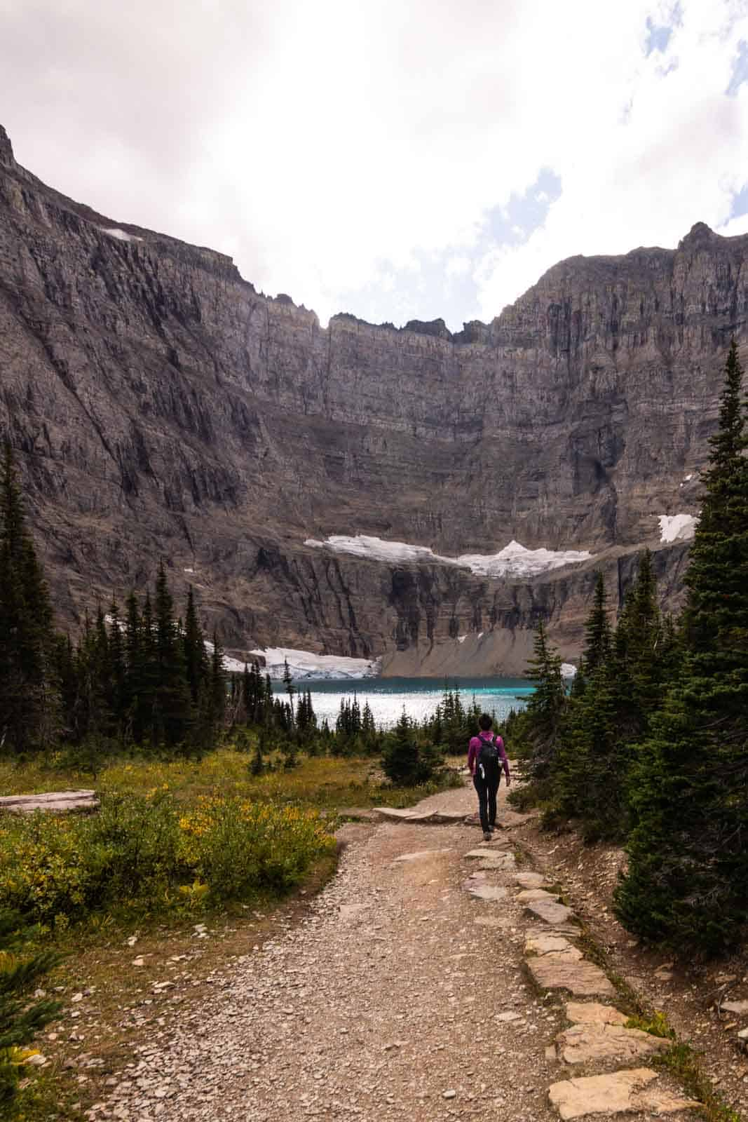 People on the Iceberg Lake trail to the best hikes in Glacier National Park