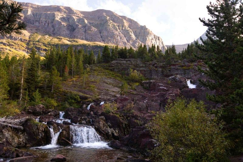 Don't miss Red Rocks Falls during a hike in Glacier National Park