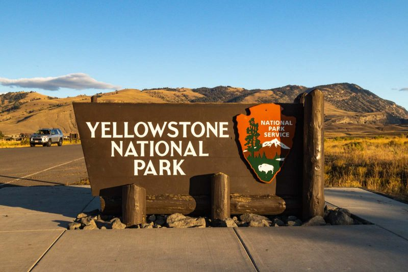 A sign for Yellowstone National Park — add this photo stop to your Yellowstone itinerary