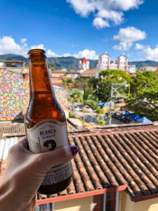 Drinking beer after a long day of day of day trips from Medellin.