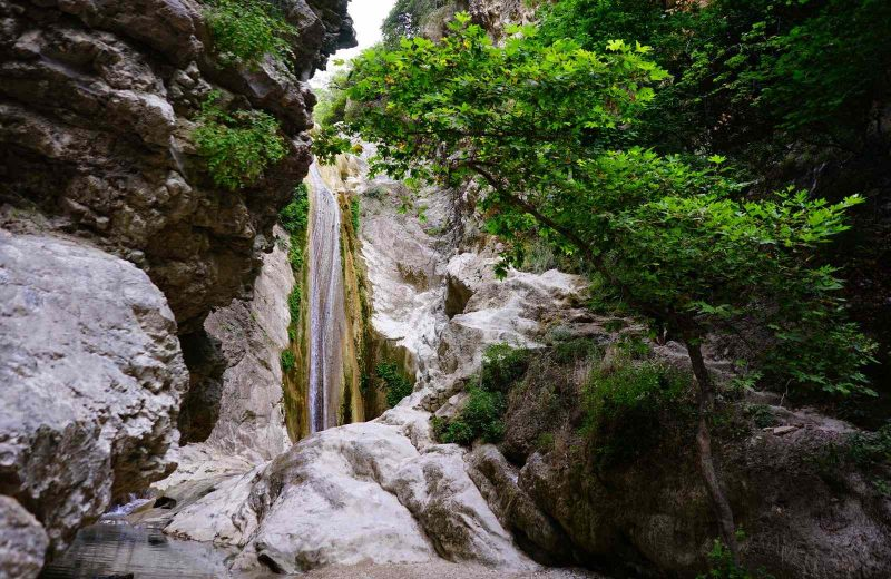 Dimossari Waterfalls are a fun place to visit on your Greek island hopping routes.