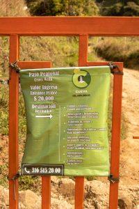 A sign showing payment information in La Cueva del Esplendor.