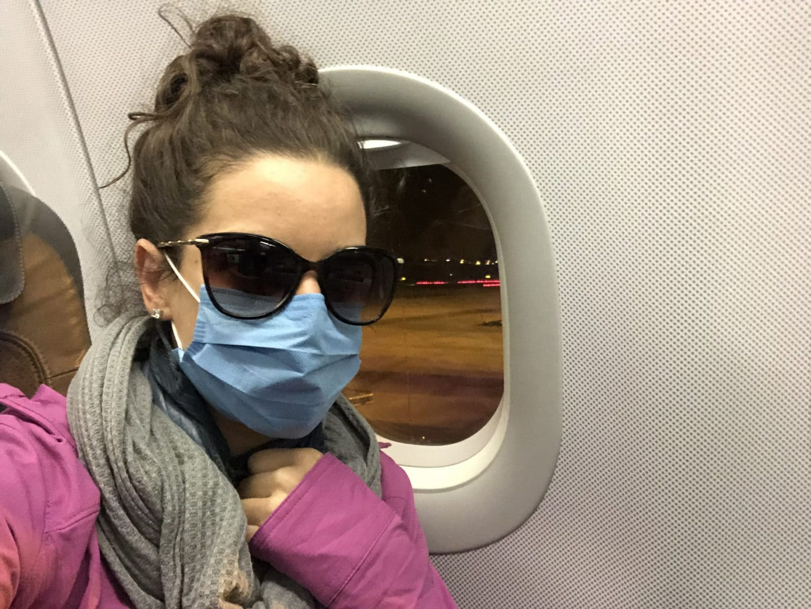 Me on a flight during the pandemic