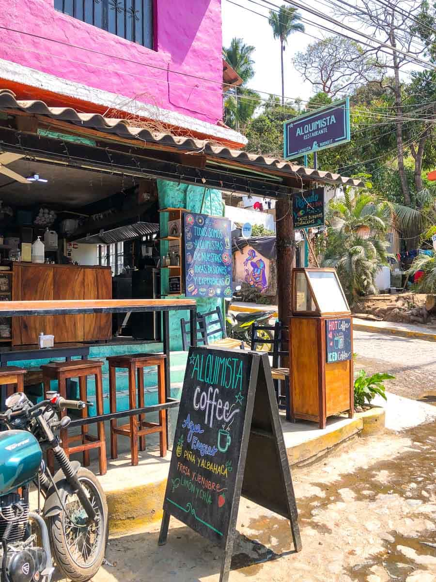 Outside of Alquimista Cafe with sandwich board out front - one of the restaurants in Sayulita