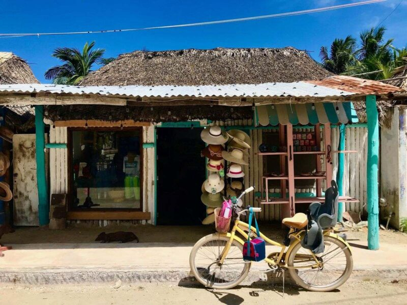 Bike parked in front of beach shack in Isla Holbox, a must for your Yucatan Itinerary