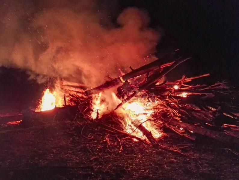 Bonfire at night to celebrate the harvest season for farm work in Australia