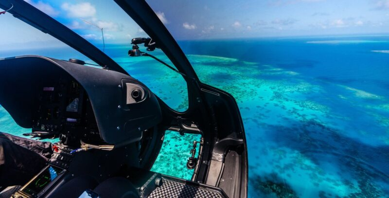 View of Great Barrier reef from Helicopter flying over it - one of the best things to do in Cairns