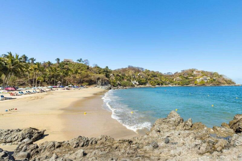 Los Muertos Beach with headland, sand and ocean, one of the best Sayulita beaches