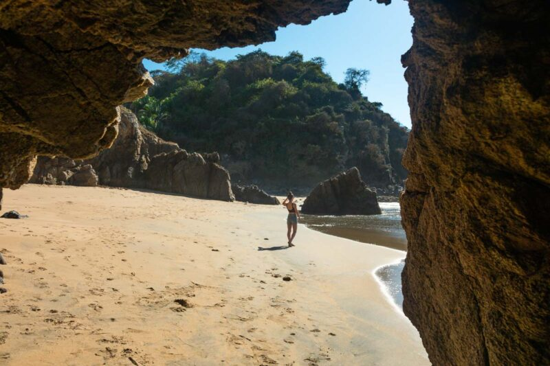 View out of Malpaso Cave to a person walking on Malpaso Beach