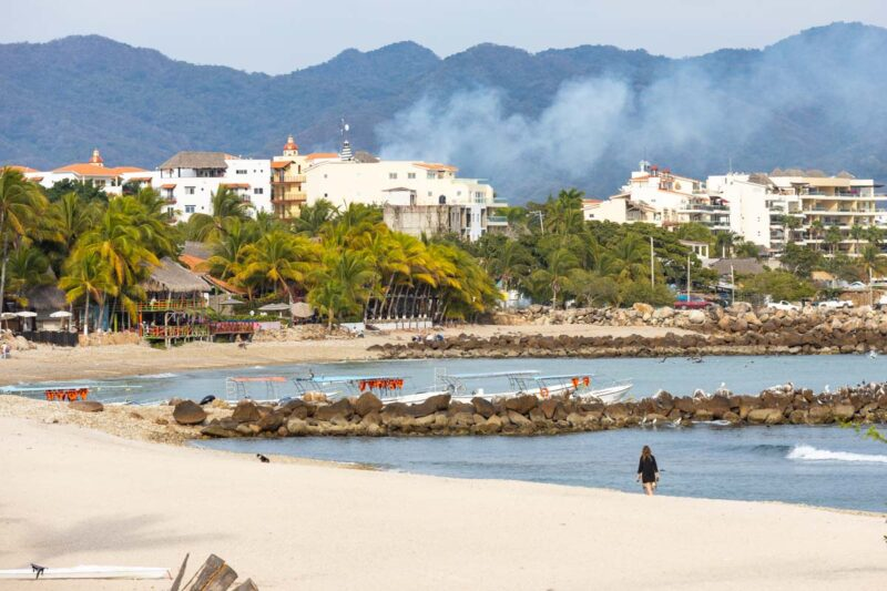 Punta de Mita Beach and ocean with buildings and mountains in background near Sayulita
