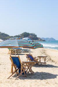 Beach chair and umbrella on sand at San Pancho beach, one of the Sayulita beaches