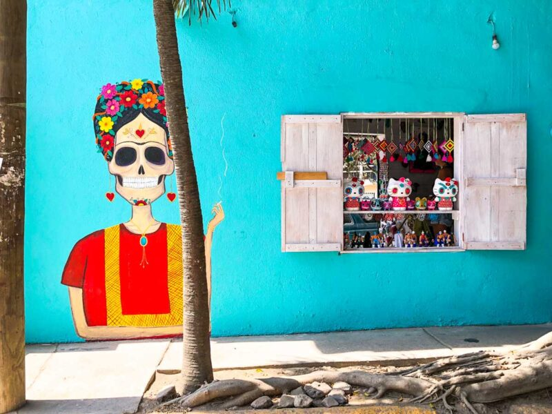 Colorful mural of a female skeleton on a wall in Sayulita, Mexico