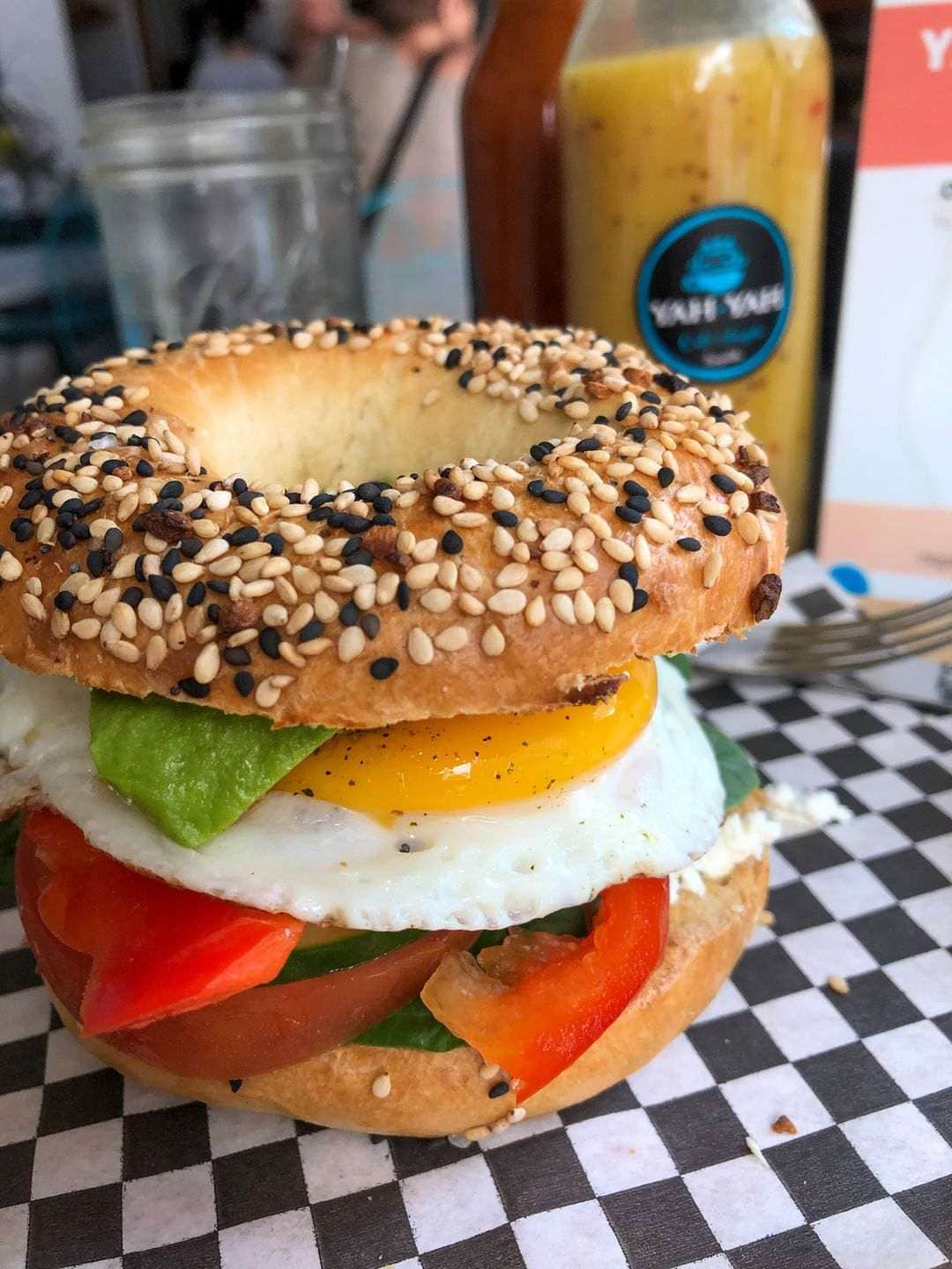 Breakfast bagel on chequered table at Yah Yahs on my list of where to eat in Sayulita
