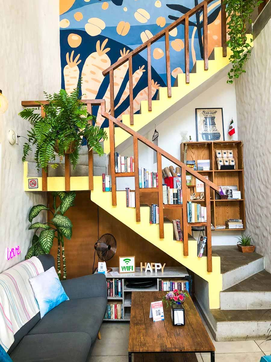 Colorful interior of Yah Yahs in Sayulita with stairs up to second floor - one of the best Sayulita Restaurants