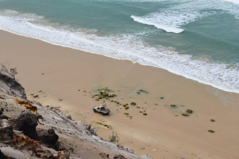 Aerial view of beach and ocean at Inskip Peninsula - visiting is one of the best things to do in Queensland