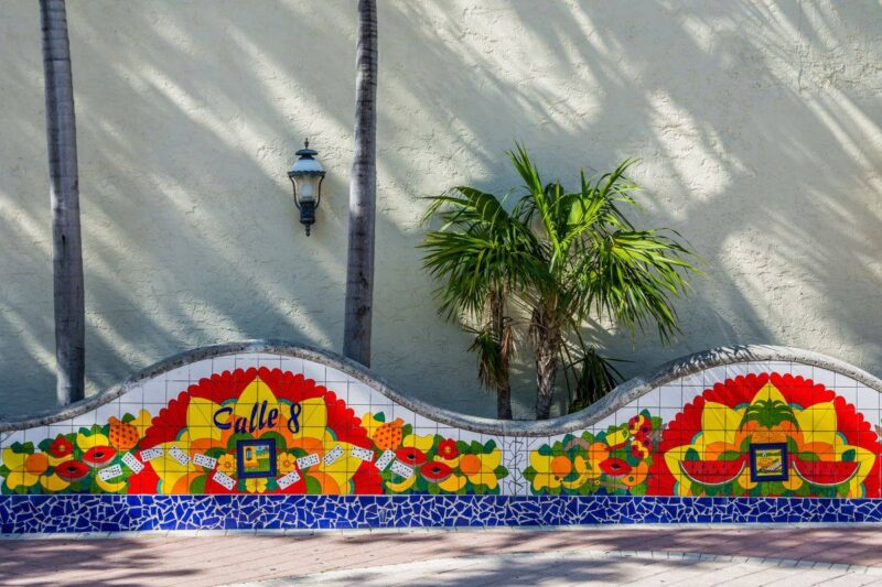 Colorful tile mosiac on wall with small palm tree in Miami