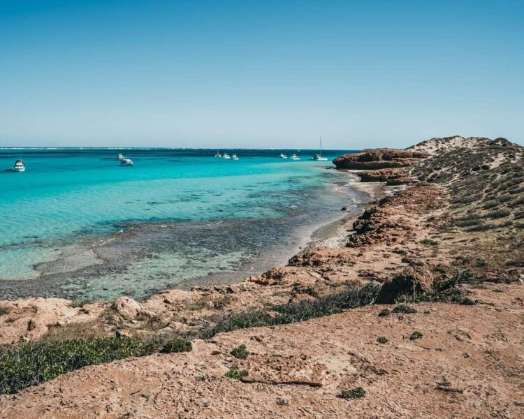 Rocky coastline with turquoise ocean - exploring the Coral Bay coast is one of the best things to do on the West Coast of Australia