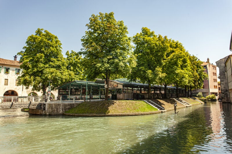 Isola della pescheria - fish market island - on river with trees in background in Treviso - one of the best day trips from Venice