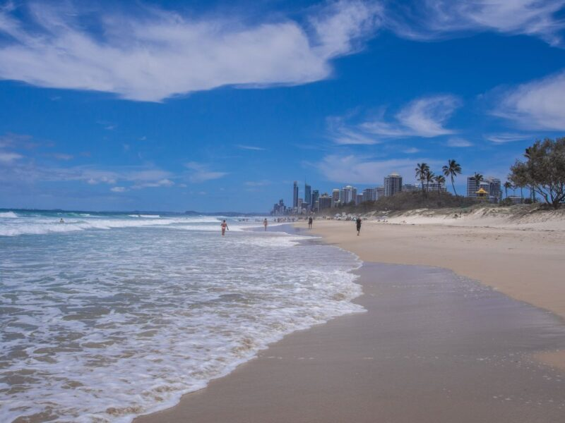 Main beach at Surfers Paradise with people walking on beach in distance