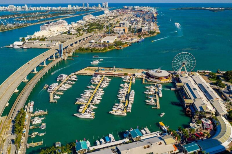 Aerial photo of Bayside Marketplace with boat marina and oversea road - a must visit during your 2 days in Miami