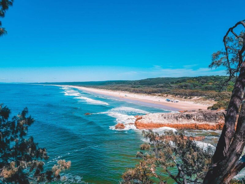 Looking out over beach and coastline of North Stradbroke Island - visiting is one of the best things to do on the Gold Coast