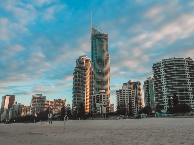 Skyscraper skyline at sunset with beach in foreground on the Gold Coast