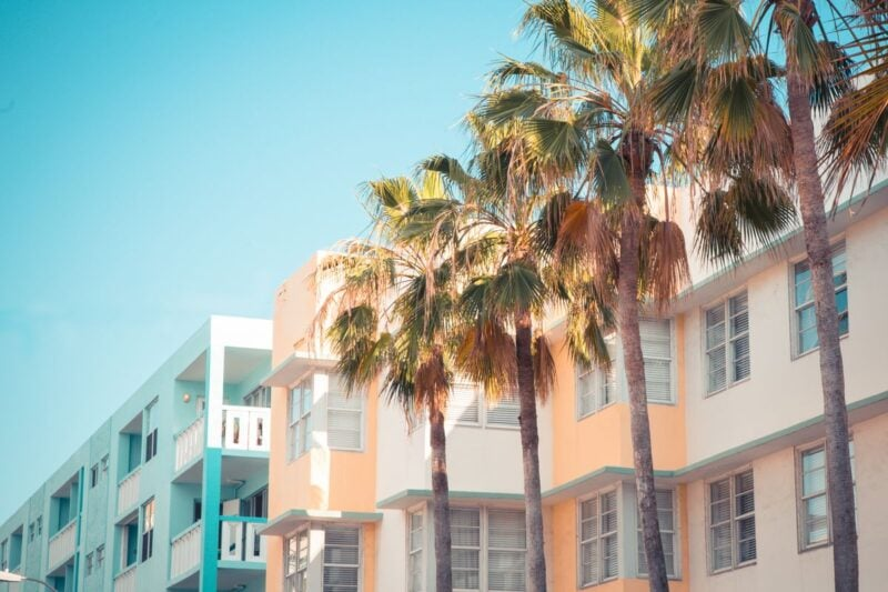 Colorful art deco buildings and palm trees in South Beach - a must visit during your 2 days in Miami