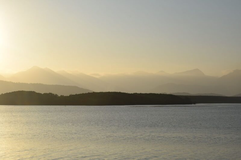 Sunset over ocean with headland in background at Port Douglas in Queensland