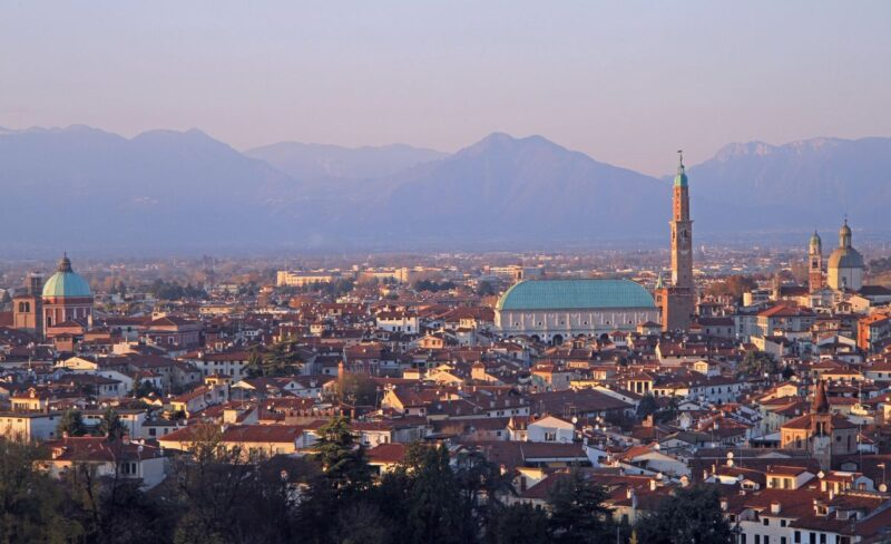 Aerial view over Vicenza just after sunset with lots of historic buildings - Vicenza is one of the best day trips from Venice
