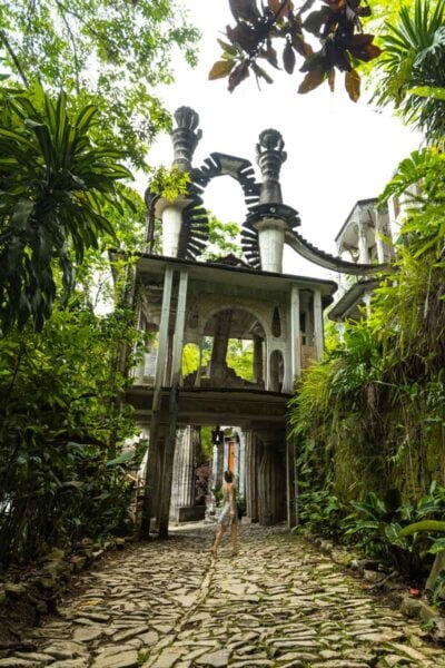 Path leading up to unusual gate surrounded by foliage in Las Pozas Xilitla Jardin